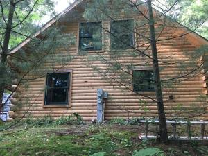 Northern white cedar log cabin after stripping with HD-80 & Citralic 2