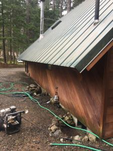 Treated Lumber Cabin before applying Timber Oil Western Cedar